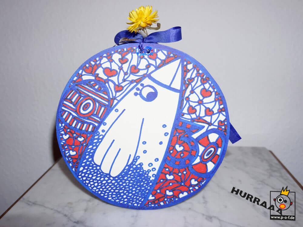 runde Geschenkverpackung mit dem Motiv Lebensvogel