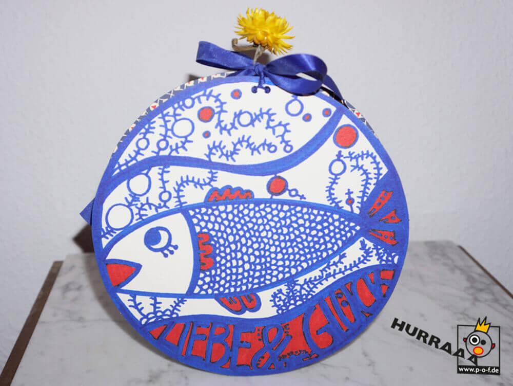 runde Geschenkverpackung mit dem Motiv Lebensfisch